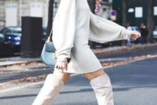 With white mini dress and blue small bag