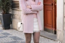 With white mini skirt and light pink sweater