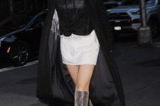 With white mini skirt, black blouse and maxi coat