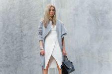 With white original dress and black bag
