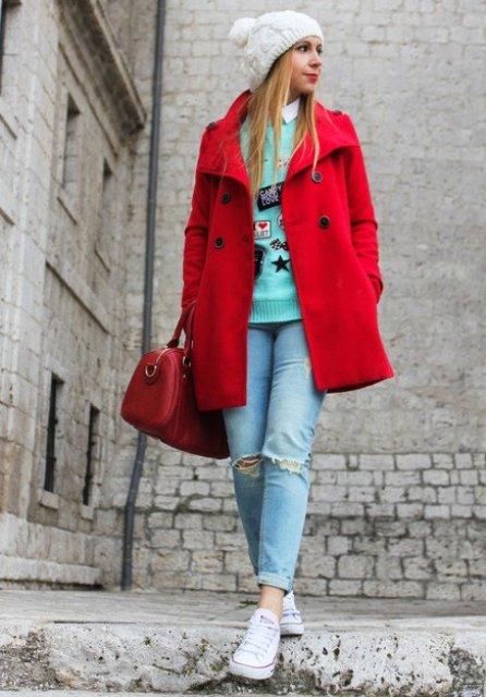 Double-breasted coat with white shirt, colored sweater, cuffed jeans and white sneakers