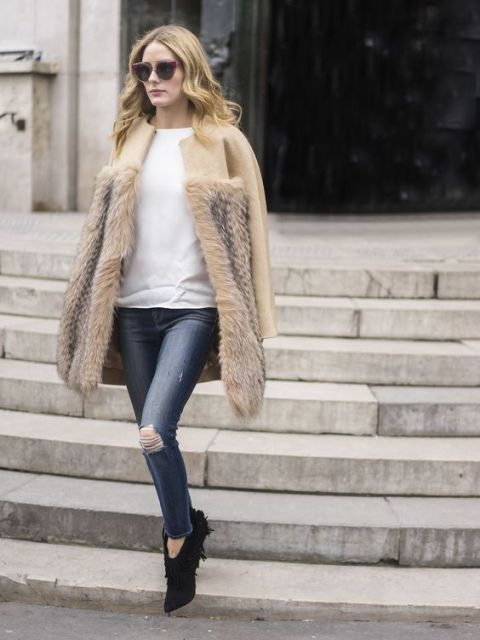 With white shirt, distressed jeans and fur coat