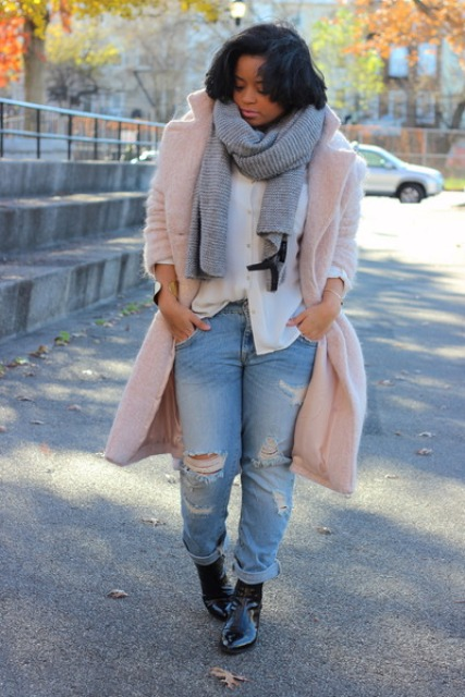 With white shirt, distressed jeans, gray scarf and black boots