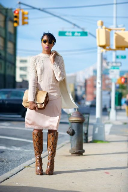With white shirt, pastel color skirt and clutch
