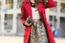 With white shirt, red coat and clutch