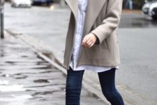 With white shirt, skinny jeans and jacket