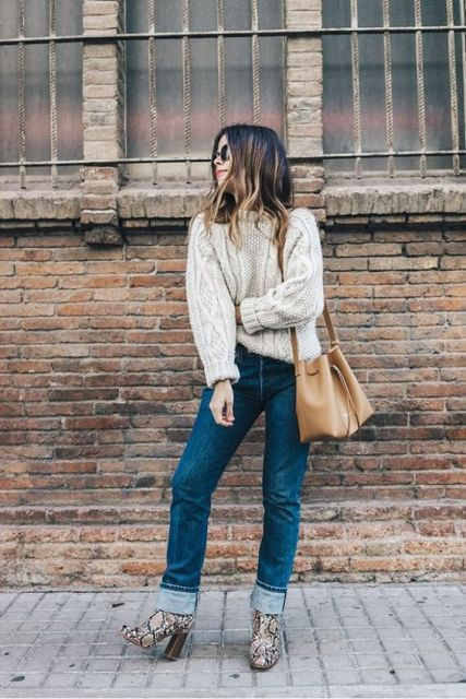 With white sweater, cuffed jeans and camel bag