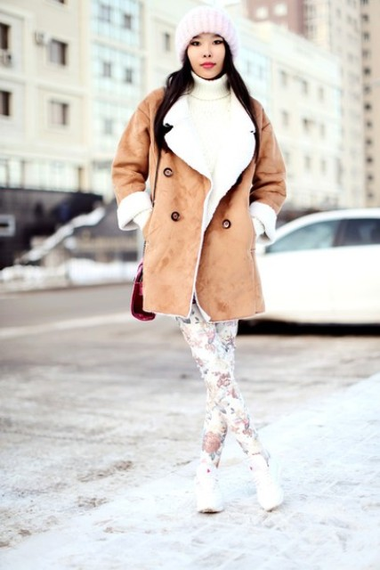 With white sweater, floral leggings and white sneakers