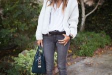 With white sweater, gray pants and emerald bag