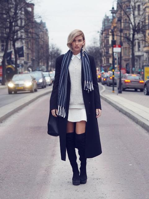 With white sweater, mini skirt and midi coat