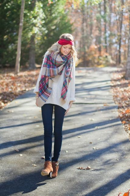 With white sweater, plaid scarf and jeans