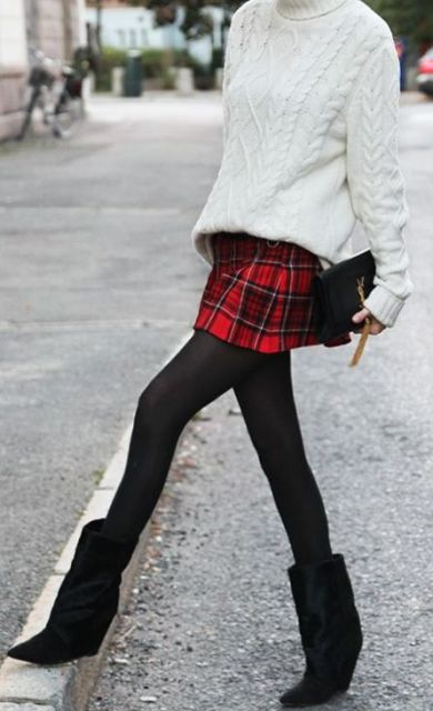 With white sweater, plaid skirt and black tights