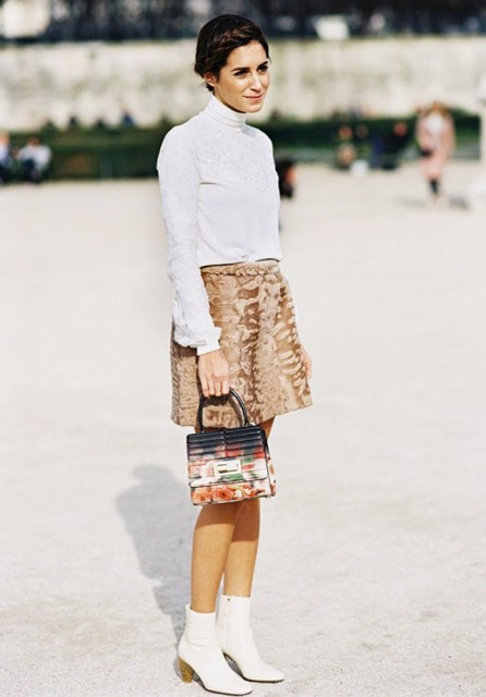 With white turtleneck, brown skirt and printed mini bag