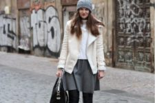 With white turtleneck, gray skirt, black over the knee boots and gray beanie