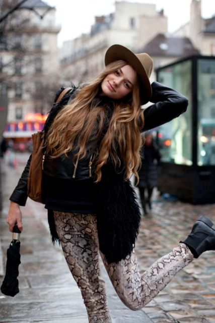 With wide brim hat, jacket with fur, flat ankle boots and leather bag