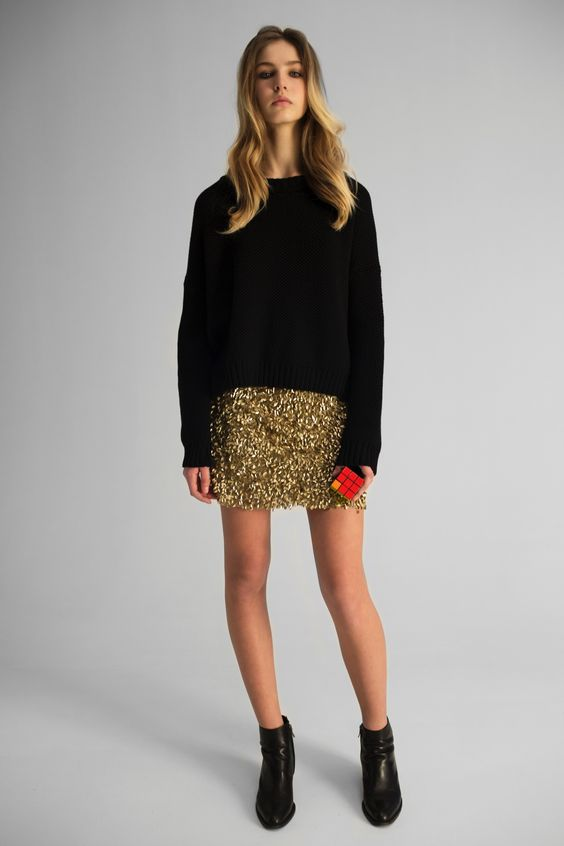 a black sweater, a gold sequin mini and heels