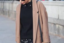 02 a black sweater, a star printed dress and a camel coat