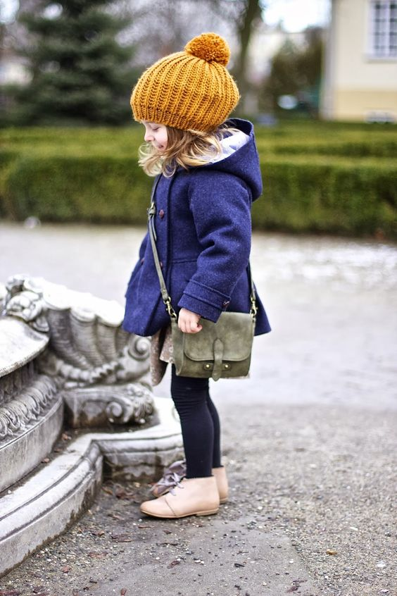 a blue coat, a yellow beanie and shoes