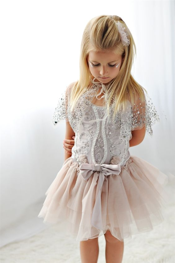 a blush tutu skirt, a silver top and capelet to feel an ice queen