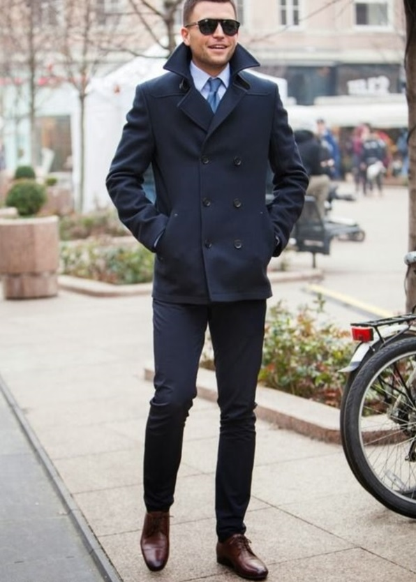 navy pants, a navy coat, brown shoes
