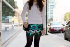 03 a bold sequined mini, a white cable knit sweater and ankle boww heels