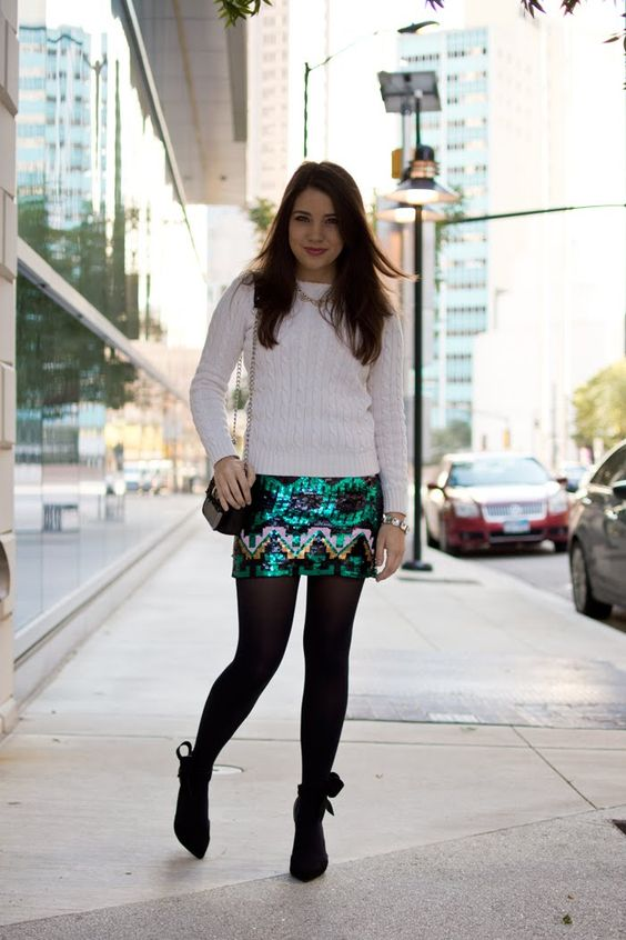 a bold sequined mini, a white cable knit sweater and ankle boww heels