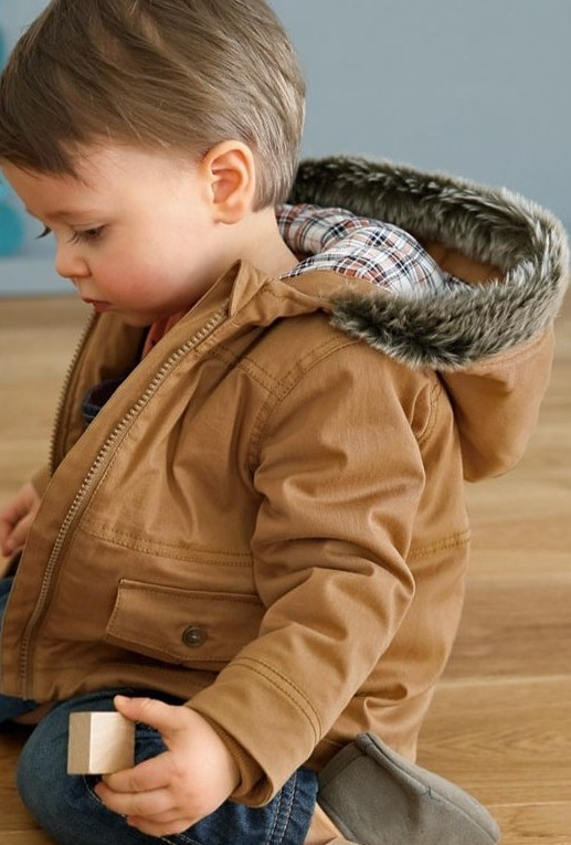 a light brown parka looks cool with grey boots