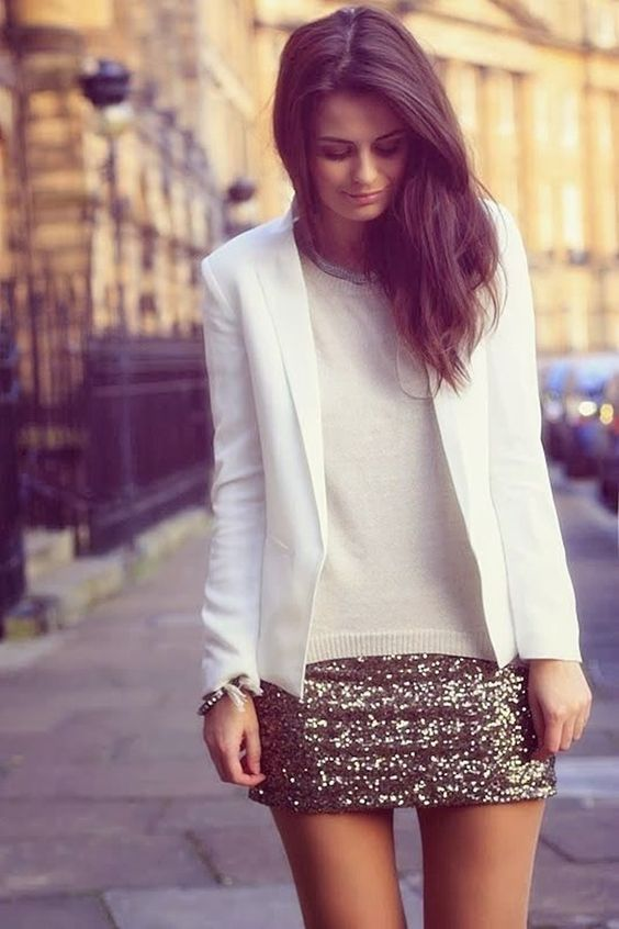 a gold mini, a white sweater and a white blazer
