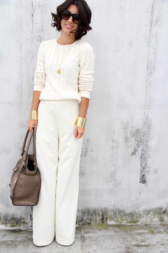 winter work outfit with a white cable knit sweater and pants, a statement bracelet