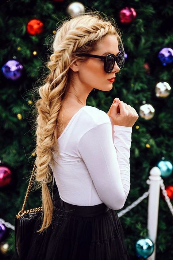 Keep your hair tied up when out to avoid fizzy hair and look good