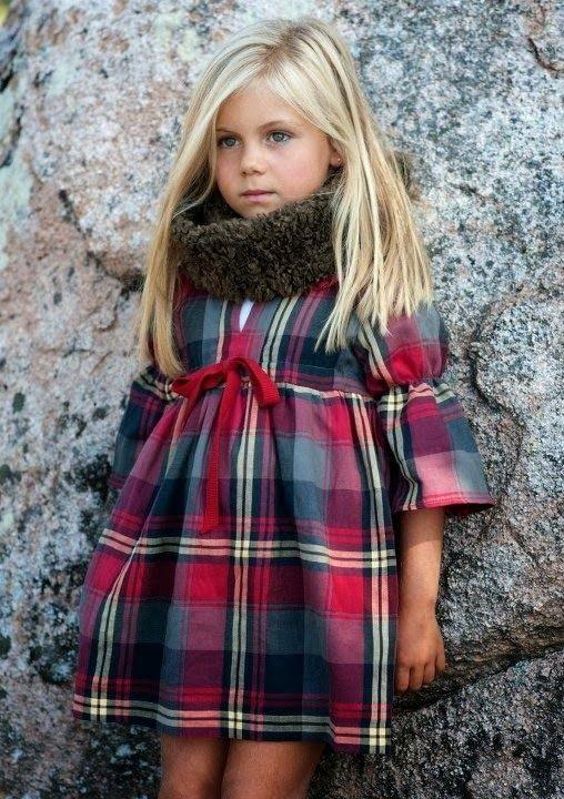 a plaid dress and a fur cowl