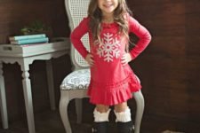 06 a red dress with a silver snowflake, high black boots and leg warmers and a black beanie