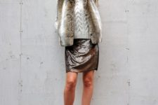 06 a sequin skirt, a cable knit sweater and a short fur coat over it
