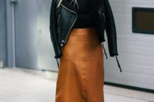 07 a leather midi skirt and corresponding boots,a black jersey and a fur coat