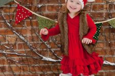 07 a red ruffle dress, a fur vest, fur boots and a knit beanie with pompoms