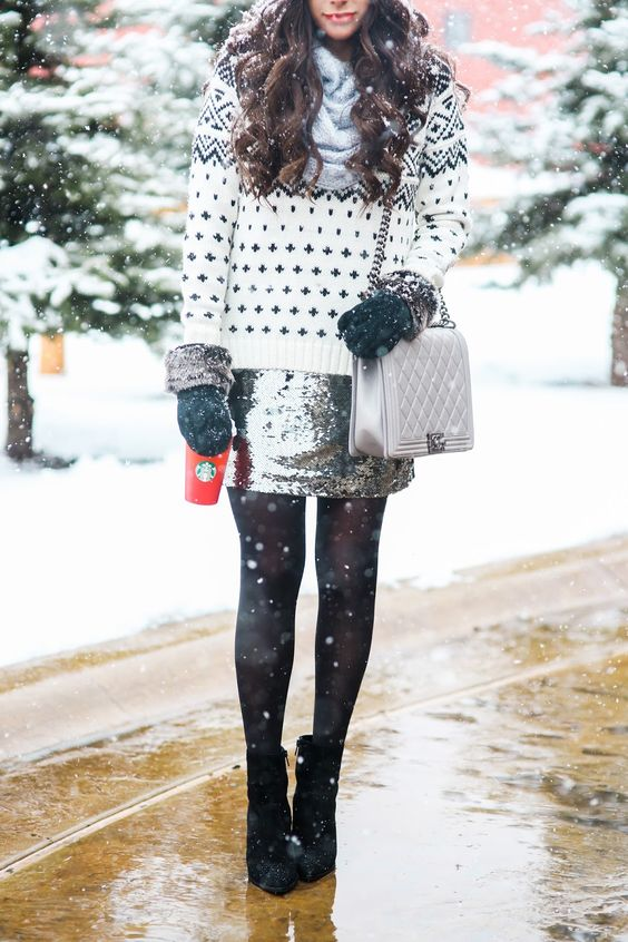 black and white sweater, a silver sequin mini and black suede boots