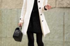 08 a patterned black mini dress, a white coat and black heels for a timeless look