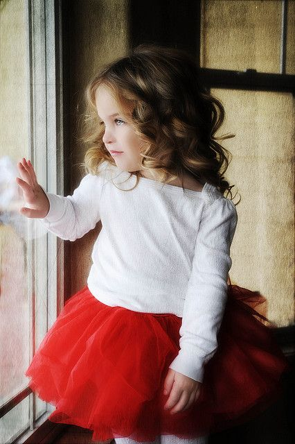 a red tutu skirt, a white long sleeve is stylish for Christmas