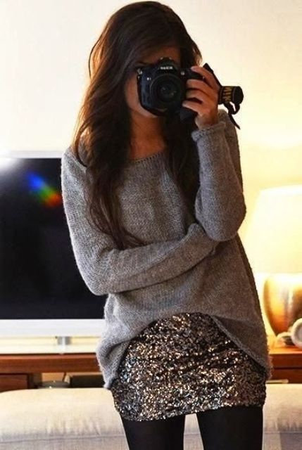an oversized grey sweater, a sequin mini and black tights