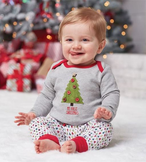 patterned pants and a grey long sleeve with a fir tree and buttons