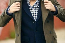 09 jeans, a navy tweed jacket, a plaid shirt and an olive green coat over