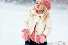 09 jeans, a pink sweater, mittens and a beanie, an ivory coat