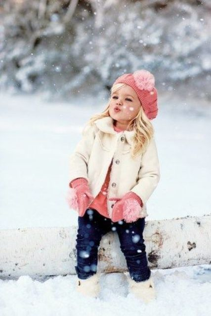 jeans, a pink sweater, mittens and a beanie, an ivory coat