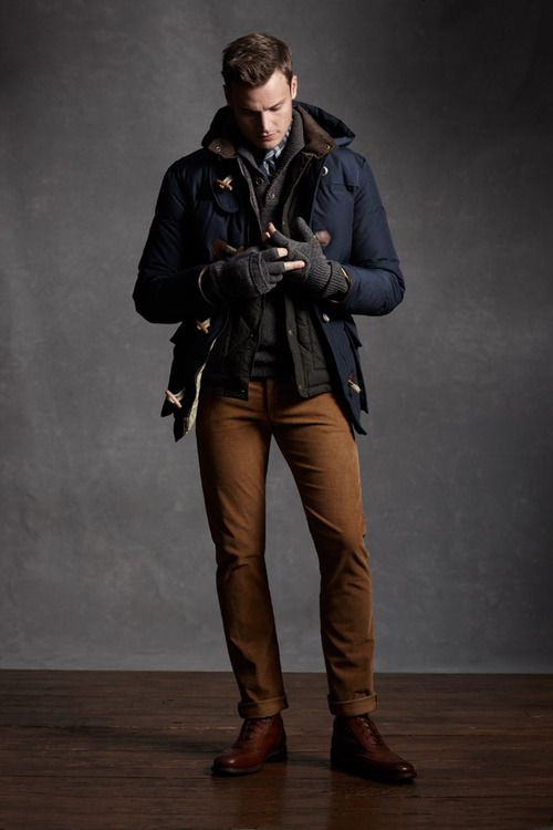 ocher pants, a navy coat and cognac boots
