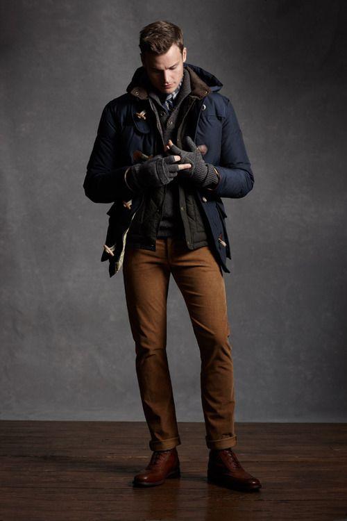 ocher pants, a navy coat and cognac boots