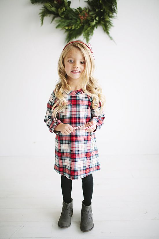 Picture Of plaid dress with black tights and grey boots