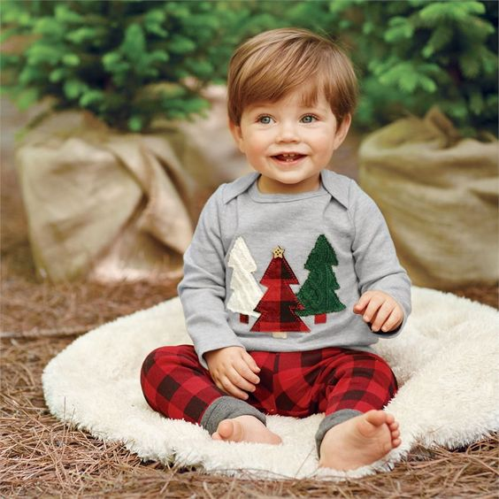 plaid pants, a grey long sleeve with fir trees