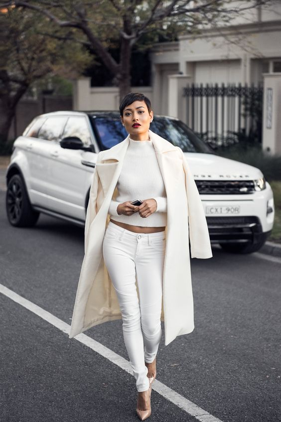 white jeans, a white crop sweater and coat