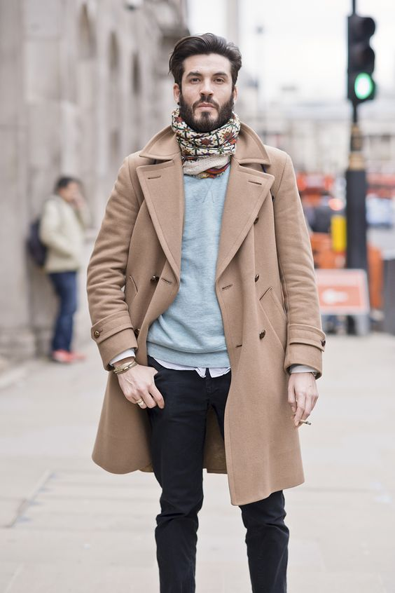 a shirt, a grey sweater, a scarf and a camel coat