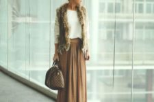 10 a tan maxi skirt, a white sweater and a fur vest